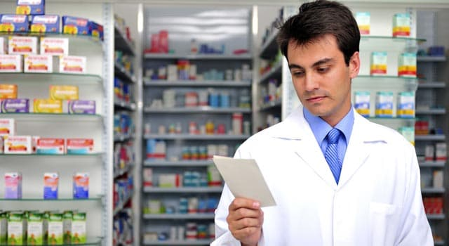 pharmacist looking at prescription pad